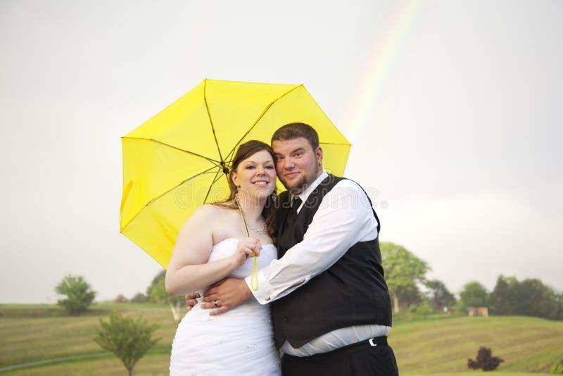 Lycklig sinande lycklig börjanregnbåge royaltyfri bild