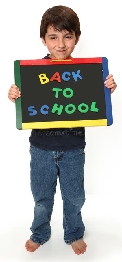 lycklig skola för tillbaka pojke till royaltyfri fotografi