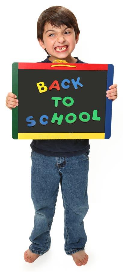 lycklig skola för tillbaka pojke till royaltyfri bild