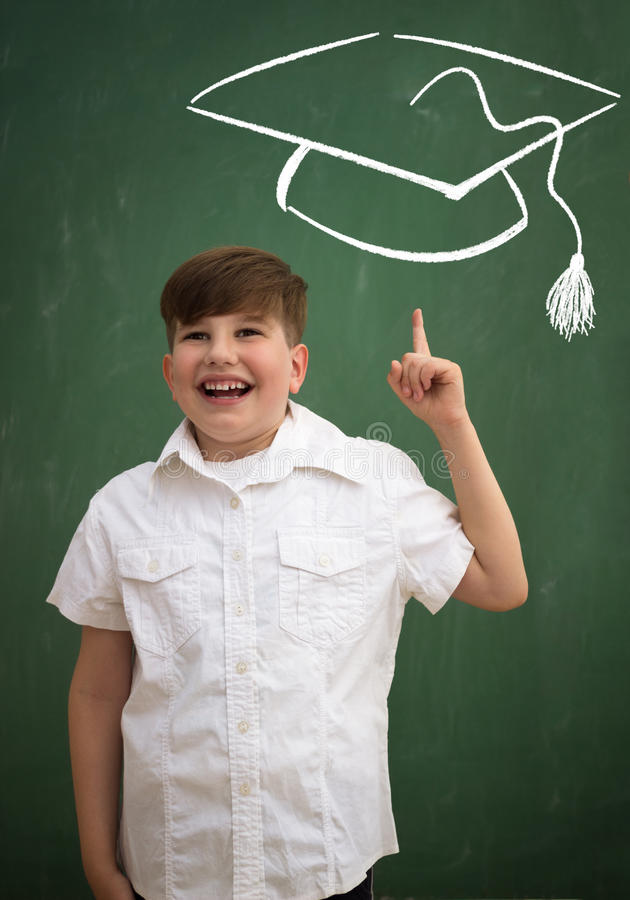 Lycklig skolpojke med idé royaltyfria foton