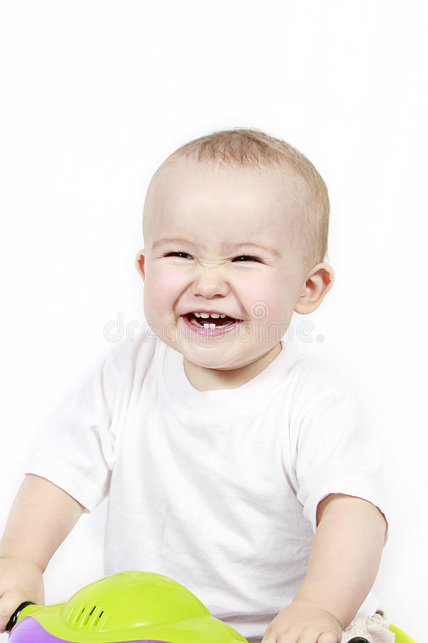 Lycklig skratta litet barn arkivbilder