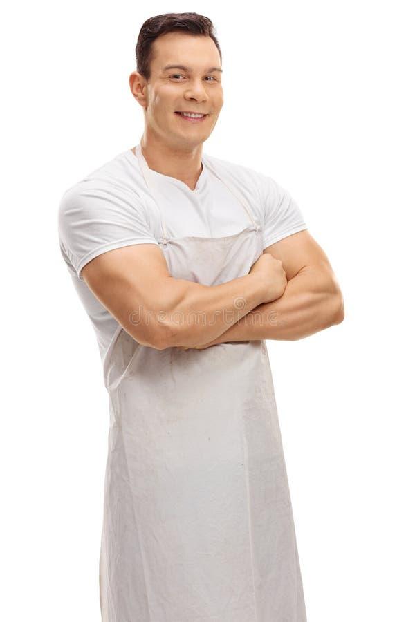 Lycklig slaktare som poserar med hans korsade armar arkivfoton