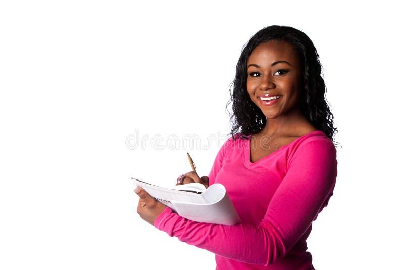 Lycklig smart student med anteckningsboken royaltyfri foto