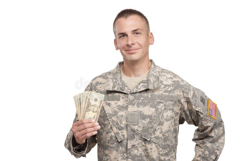 Den le militären rymmer pengar royaltyfri fotografi