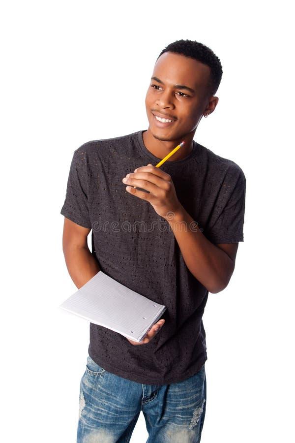 Lycklig student med notepaden arkivbilder