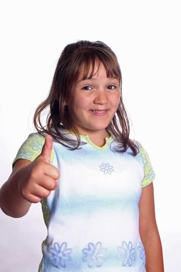lycklig tum för flicka upp arkivfoto