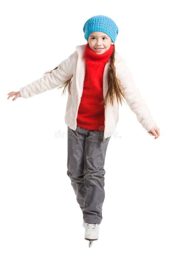 Lycklig ung flickakonståkning som isoleras arkivfoton