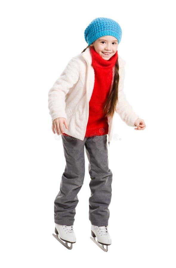 Lycklig ung flickakonståkning som isoleras arkivfoto