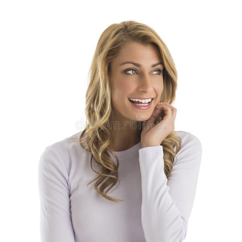 Lycklig ung kvinna som bort ser royaltyfria foton