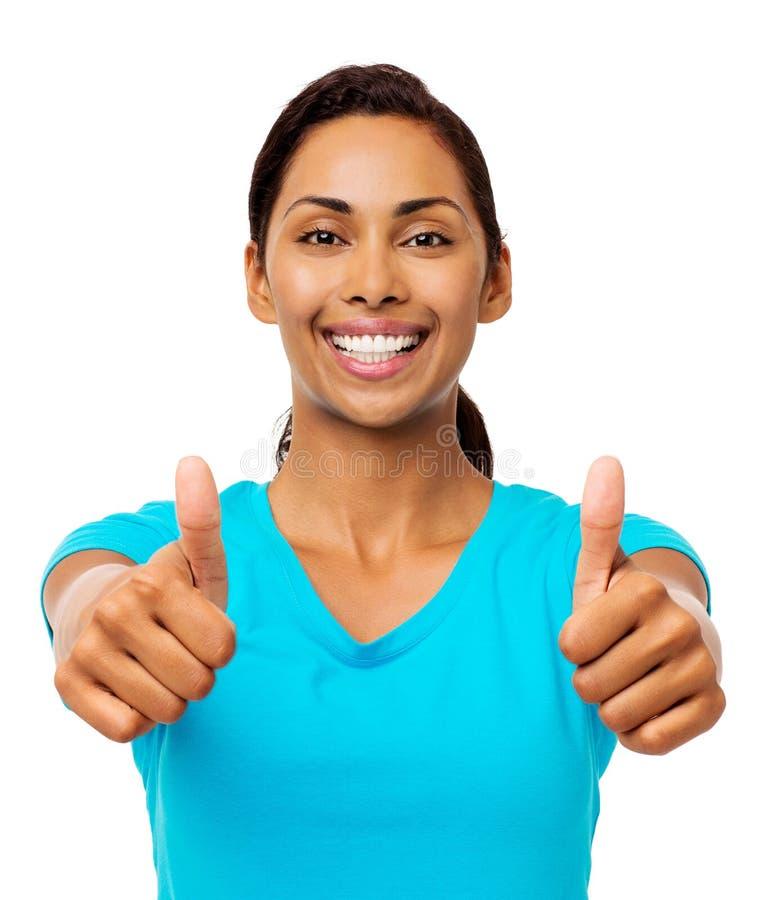 Lycklig ung kvinna som gör en gest upp tummar royaltyfria foton