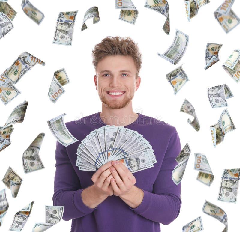 Lycklig ung man med pengar på vit royaltyfri foto