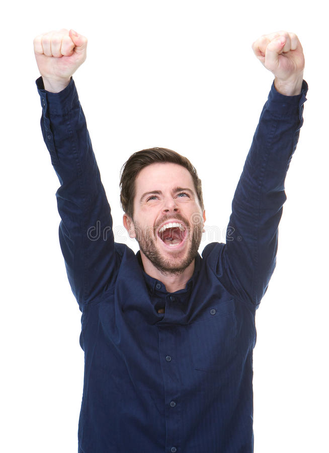 Lycklig ung man som firar med lyftta armar arkivbilder