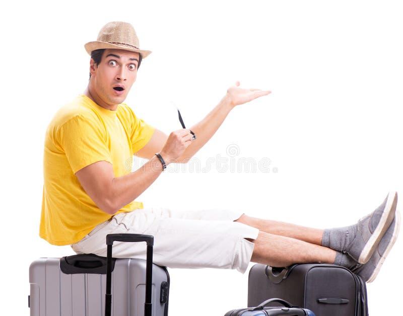 Lycklig ung man som g?r p? sommarsemestern som isoleras p? vit arkivfoton