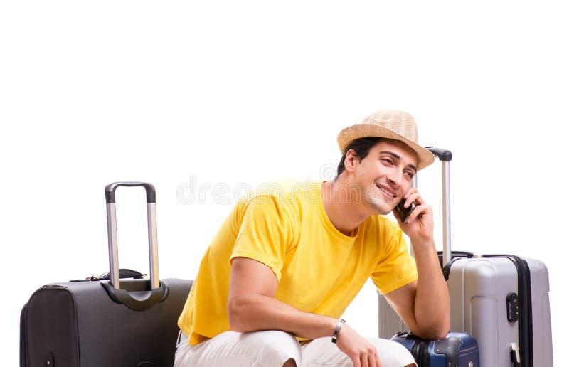 Lycklig ung man som g?r p? sommarsemestern som isoleras p? vit arkivfoto