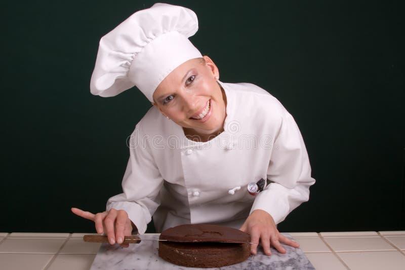 lycklig utjämning för cake arkivbild
