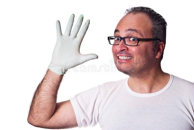 Lycklig vuxen människa i Rubber handskar royaltyfria foton