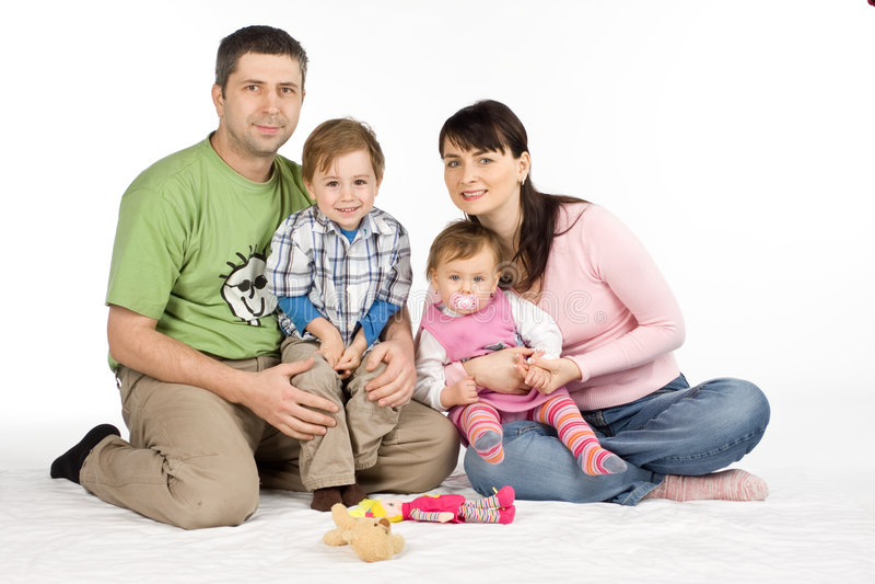 lycklig white för familj arkivfoto