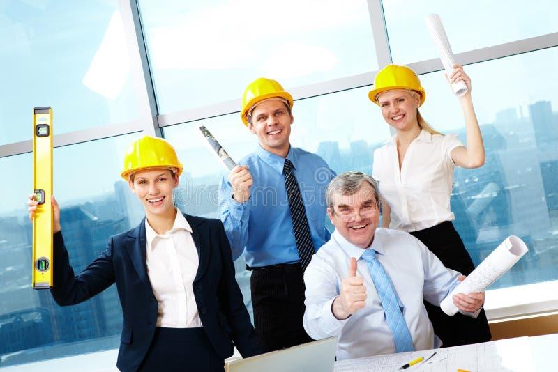 lyckliga arbetare arkivfoton
