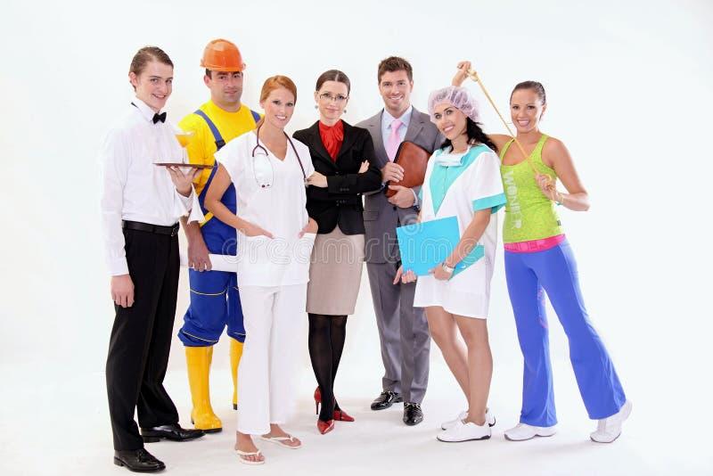 lyckliga arbetare för grupp royaltyfri bild