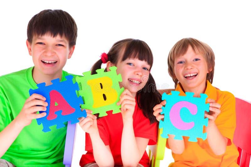 lyckliga barn arkivfoto