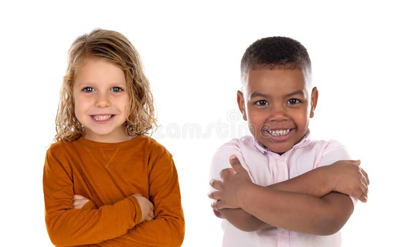 Lyckliga barn som ser kameran royaltyfria foton