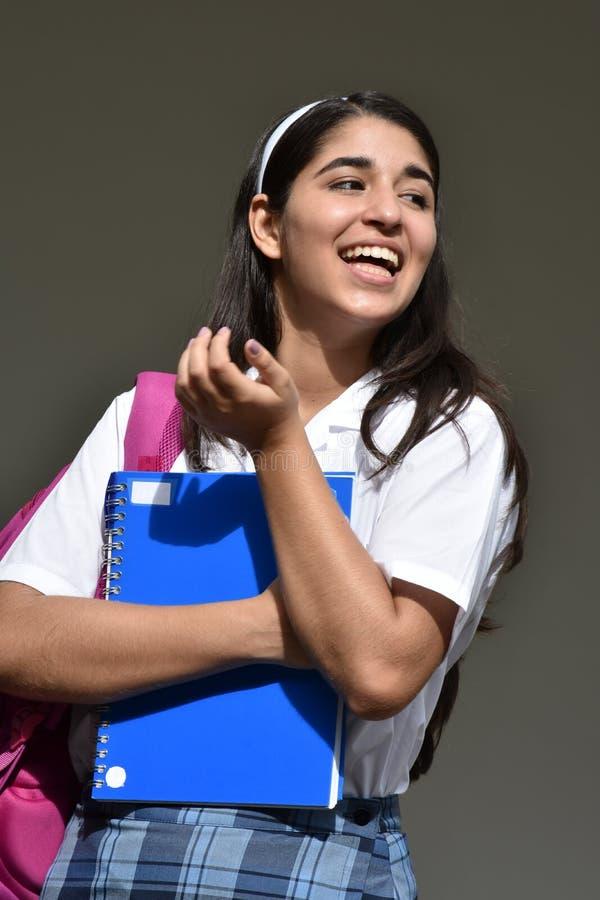 Lyckliga colombianska Person With Notebook royaltyfri foto