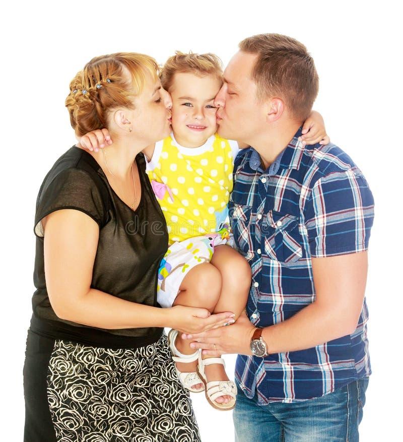 Lyckliga föräldrar och ung dotter royaltyfri fotografi