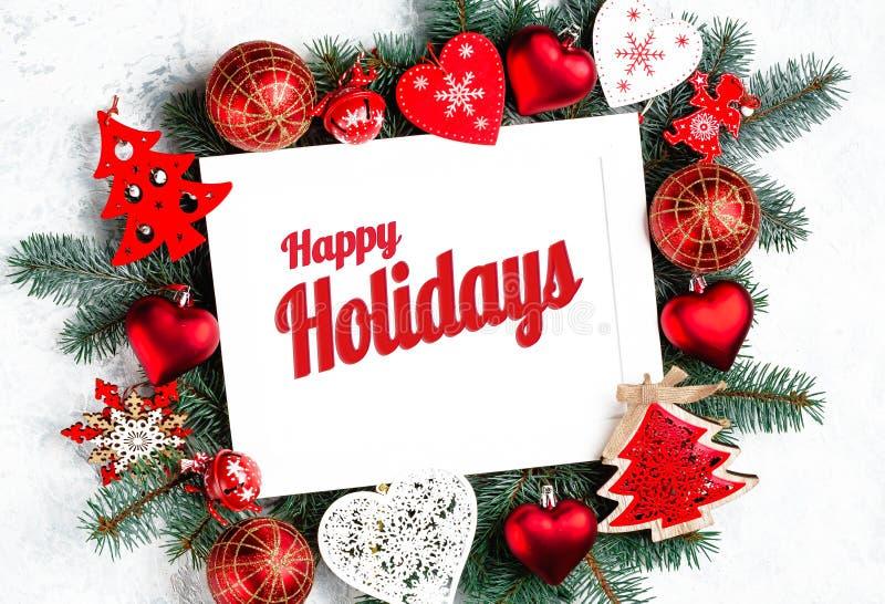 Lyckliga ferier smsar med vintergröna filialer för ferie och trädet för nytt år för photoframe, den bästa sikten för garneringar, arkivbild