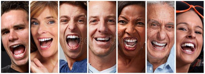 Lyckliga folkframsidor royaltyfria bilder