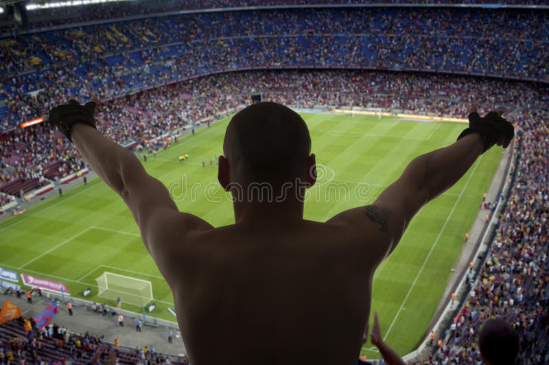 Lyckliga fotbollfans fotografering för bildbyråer