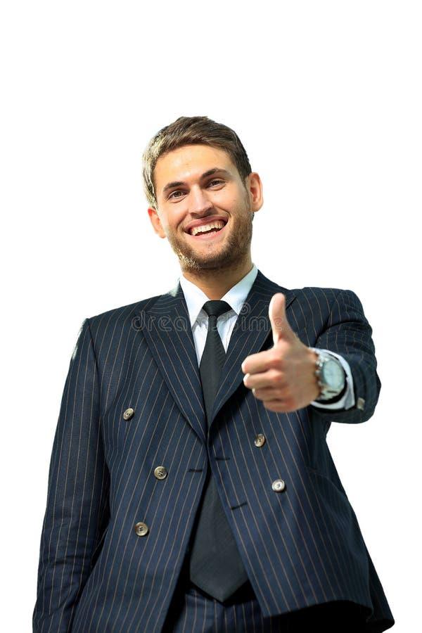 Lyckliga gående tummar för affärsman upp, fotografering för bildbyråer