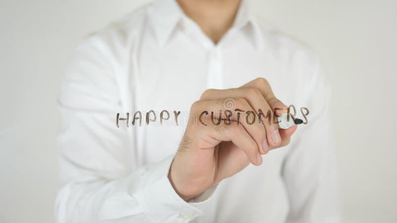 Lyckliga kunder som är skriftliga på exponeringsglas arkivbild