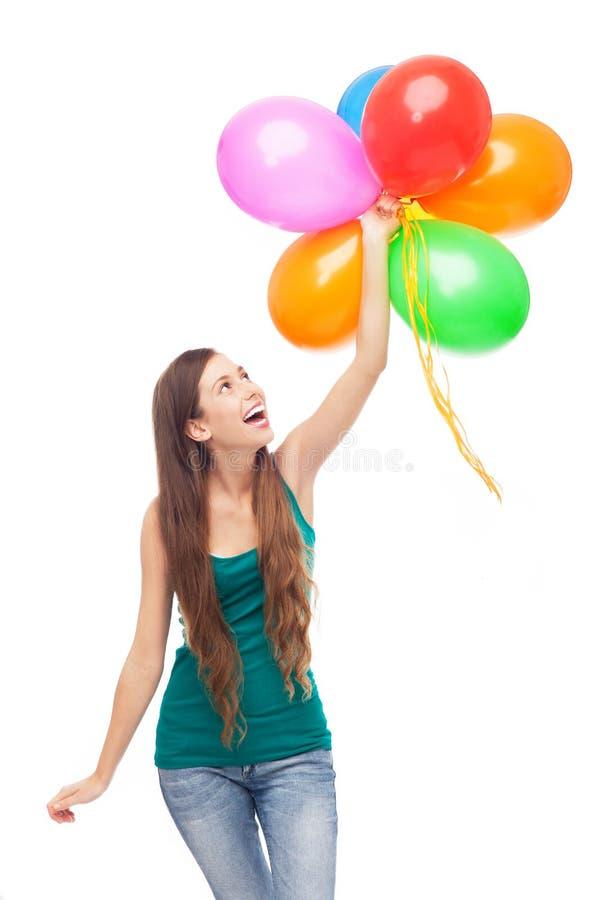 Lyckliga Kvinnaholdingballonger Royaltyfria Bilder
