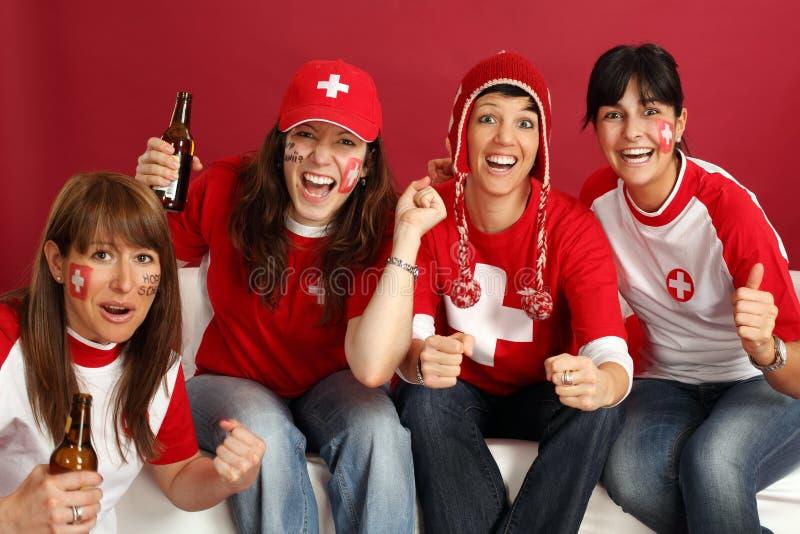 Lyckliga kvinnligsportventilatorer royaltyfri bild
