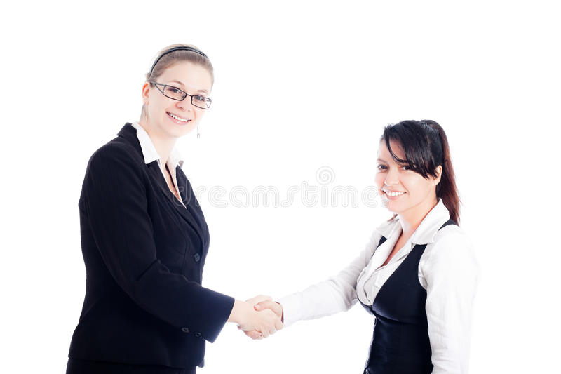 lyckliga kvinnor för affärshandskakning royaltyfria bilder