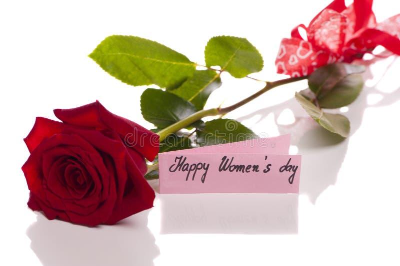 Lyckliga kvinnors dag - kort med den röda rosen royaltyfri foto