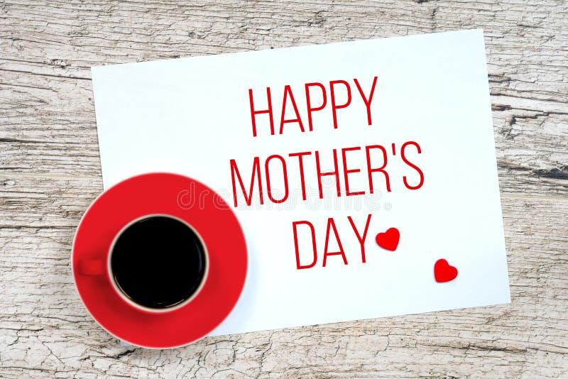 Lyckliga moders dag hälsningskort med kaffekoppen arkivfoton