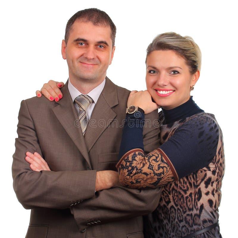 Lyckliga par som isoleras på vit fotografering för bildbyråer