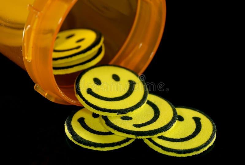 lyckliga pills fotografering för bildbyråer