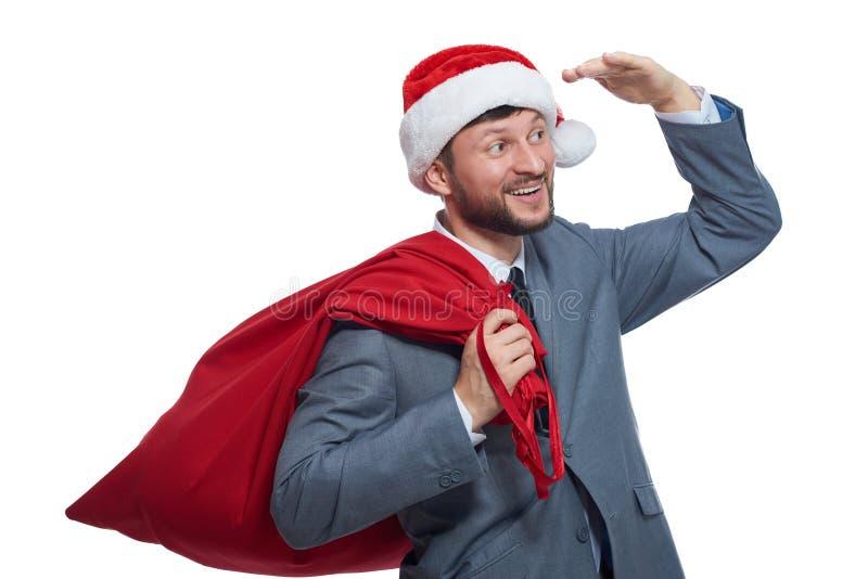 Lyckliga Santa Claus med gåvor som bort ser avstånd royaltyfria bilder