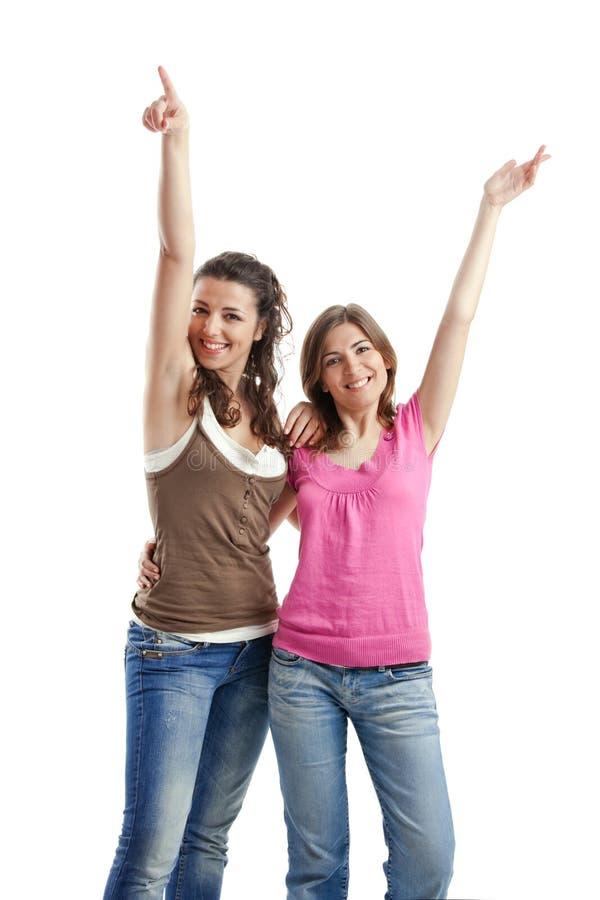lyckliga unga s-kvinnor arkivfoto