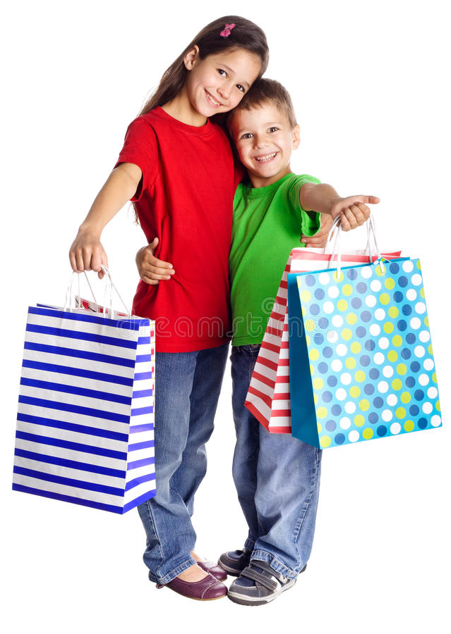 Lyckliga ungar med shoppingpåsar arkivfoto