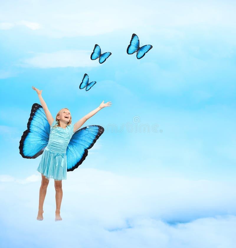 lyckligt barn för fjärilsflicka arkivfoton