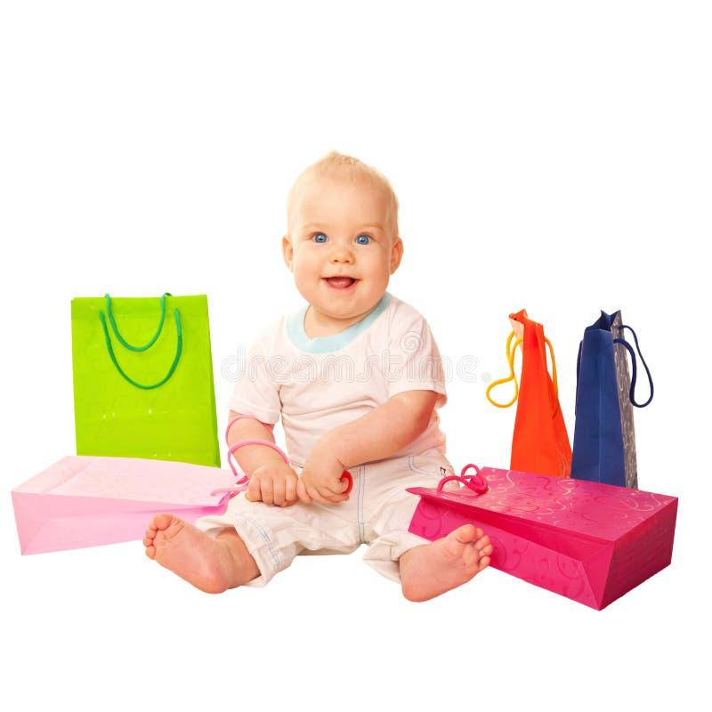 Lyckligt behandla som ett barn shopping Isolerat på vit arkivfoto