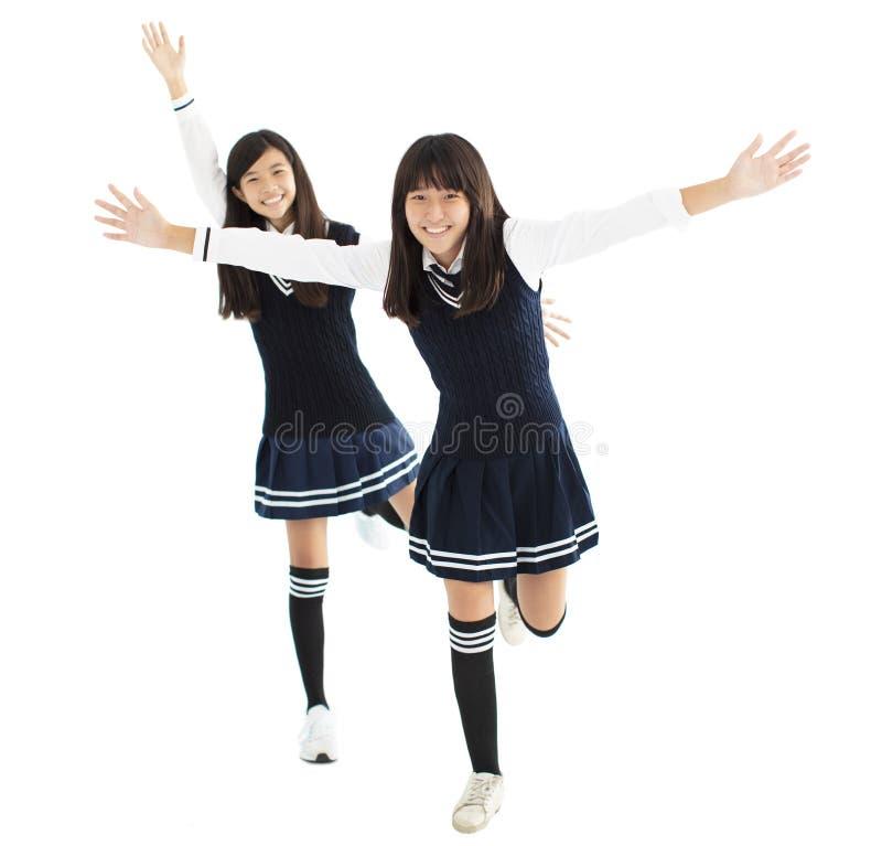 lyckligt dansa för tonåringstudentflickor royaltyfri foto