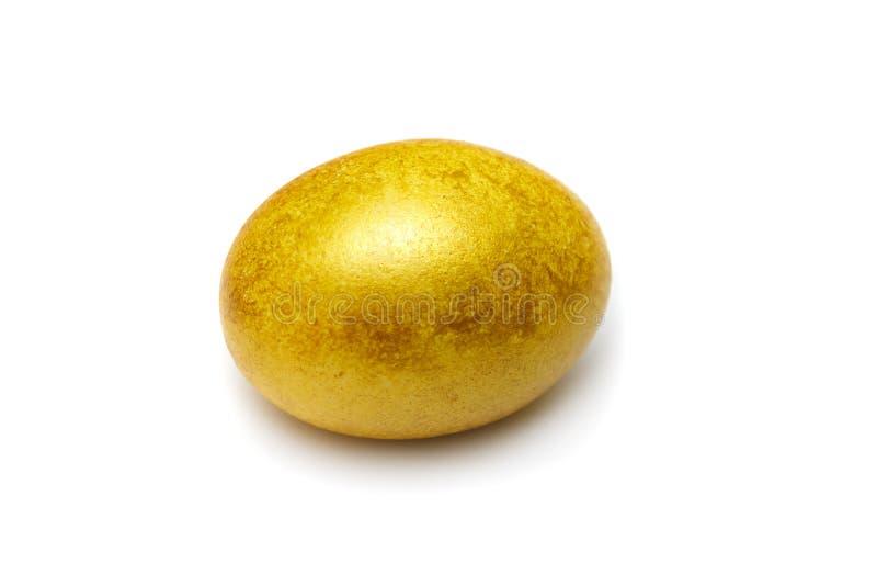 Lyckligt easter guld- ägg arkivbilder