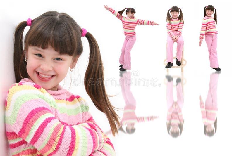 lyckligt gammalt sju år för härlig flicka arkivfoto