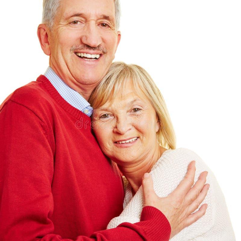 lyckligt högt le för par arkivfoto