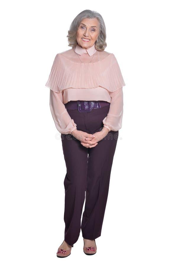 Lyckligt högt posera för kvinna arkivfoton