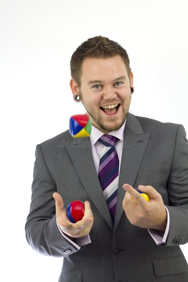 lyckligt jonglera för affärsman royaltyfri fotografi